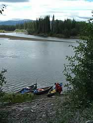 Filling canoes on the Dease River